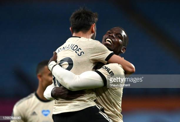 Paul Pogba of Manchester United celebrates with Bruno Fernandes after scoring his team's third goal during the Premier League match between Aston...