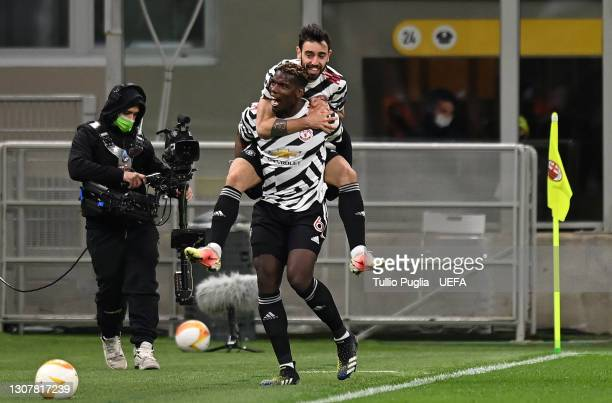 Paul Pogba of Manchester United celebrates with Bruno Fernandes after scoring their side's first goal during the UEFA Europa League Round of 16...
