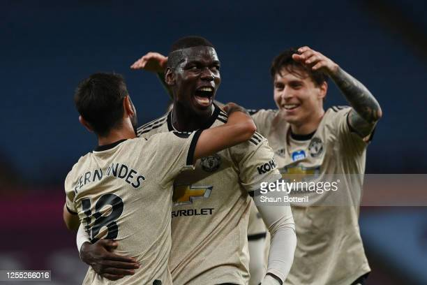 Paul Pogba of Manchester United celebrates with Bruno Fernandes and Victor Lindelof after scoring his team's third goal during the Premier League...