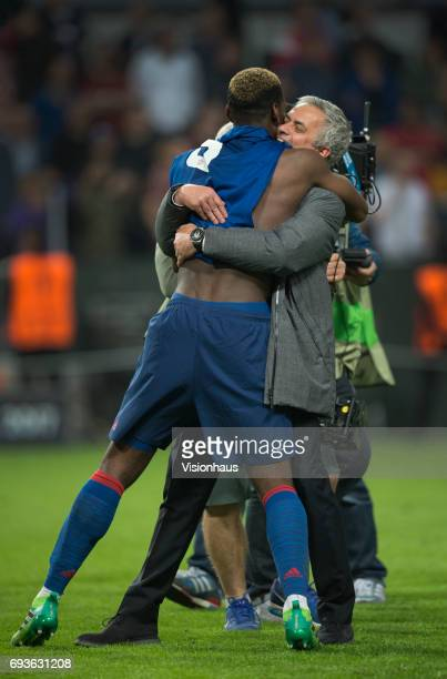 Paul Pogba of Manchester United celebrates with coach Jose Mourinho after winning the Europa League Final between Manchester United and AFC Ajax at...