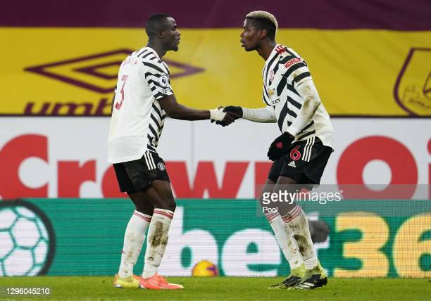 Paul Pogba of Manchester United celebrates with Eric Bailly after scoring their team's first goal during the Premier League match between Burnley and...