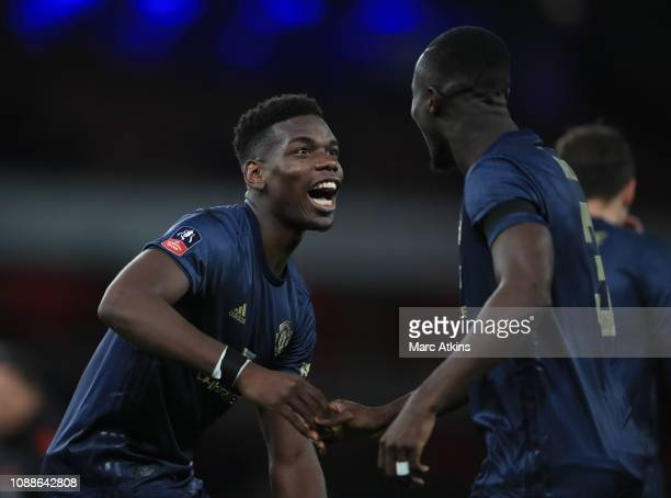 Paul Pogba of Manchester United celebrates with Eric Bailly during the FA Cup Fourth Round match between Arsenal and Manchester United at Emirates...