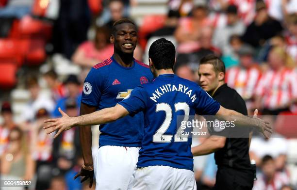 Paul Pogba of Manchester United celebrates with goalscorer Henrikh Mkhitaryan of Manchester United after their second goal during the Premier League...