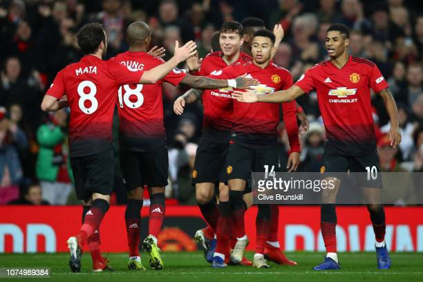 Paul Pogba of Manchester United celebrates with his team mates after scoring their team's second goal during the Premier League match between...
