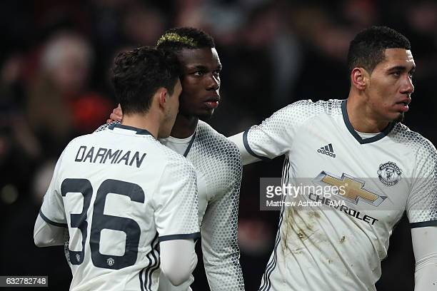 Paul Pogba of Manchester United celebrates with his team-mates after scoring a goal to make the score 1-1 during the EFL Cup Semi-Final second leg...