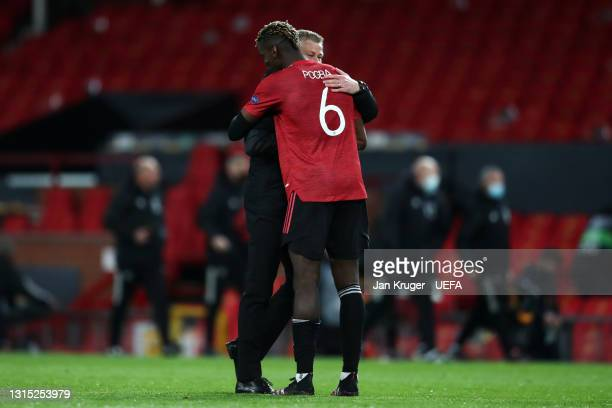 Paul Pogba of Manchester United celebrates with Ole Gunnar Solskjaer, Manager of Manchester United following the UEFA Europa League Semi-final First...