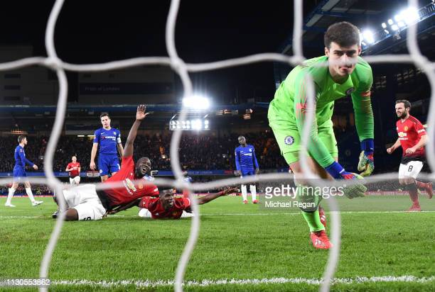 Paul Pogba of Manchester United celebrates with Romelu Lukaku as he scores his team's second goal as Kepa Arrizabalaga of Chelsea reacts during the...