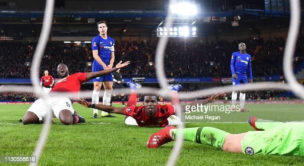 Paul Pogba of Manchester United celebrates with Romelu Lukaku as he scores his team's second goal during the FA Cup Fifth Round match between Chelsea...