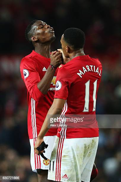 Paul Pogba of Manchester United celebrates with team mate Anthony Martial after victory in the Premier League match between Manchester United and...