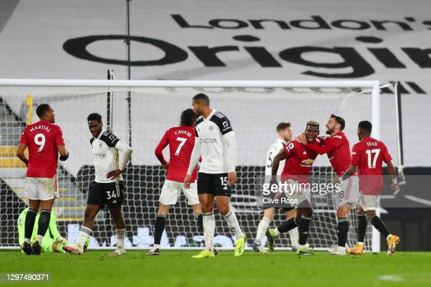 Paul Pogba of Manchester United celebrates with team mate Bruno Fernandes of Manchester United after scoring their side's second goal during the...