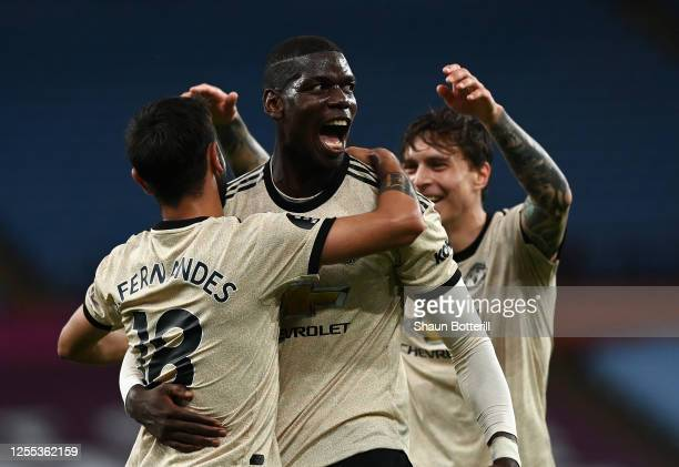 Paul Pogba of Manchester United celebrates with team mate Bruno Fernandes after scoring the third goal during the Premier League match between Aston...