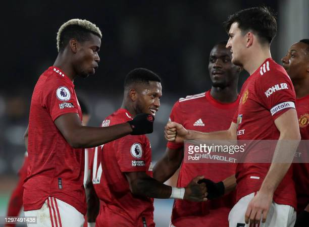 Paul Pogba of Manchester United celebrates with team mate Harry Maguire after scoring their side's second goal during the Premier League match...