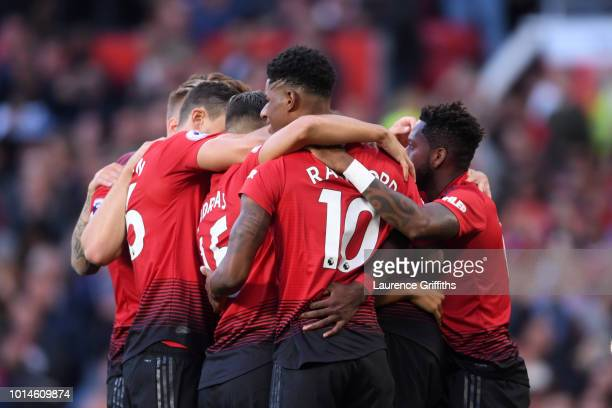 Paul Pogba of Manchester United celebrates with team mates after scoring his team's first goal during the Premier League match between Manchester...
