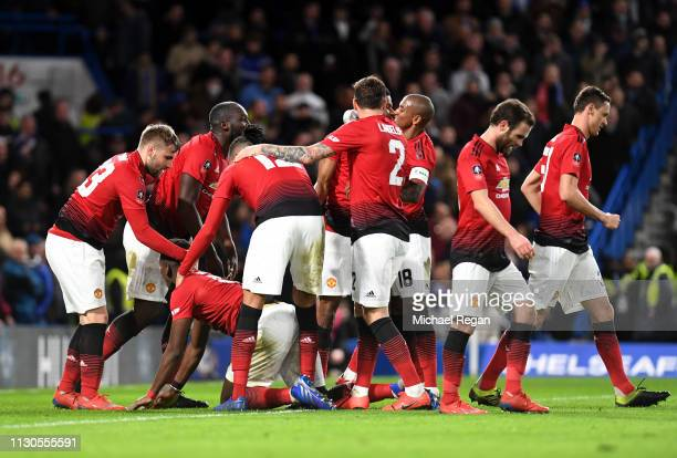 Paul Pogba of Manchester United celebrates with team mates as he scores his team's second goal during the FA Cup Fifth Round match between Chelsea...