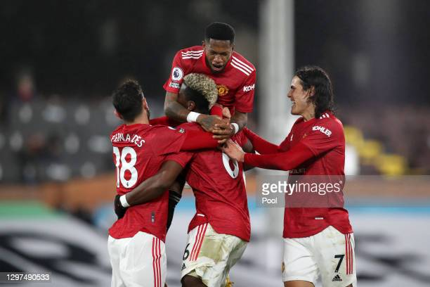 Paul Pogba of Manchester United celebrates with team mates Bruno Fernandes, Fred and Edinson Cavani after scoring their side's second goal during the...