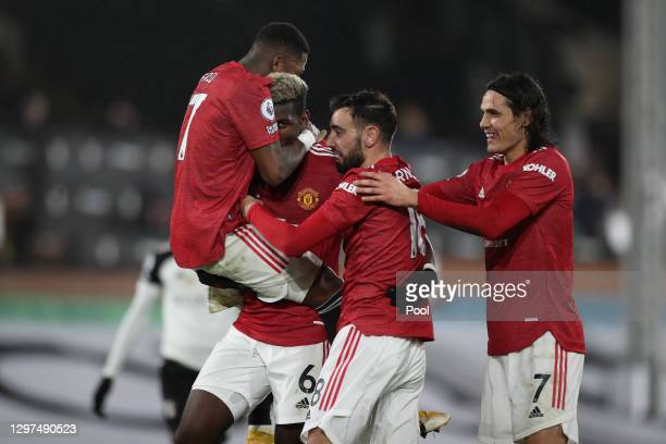 Paul Pogba of Manchester United celebrates with team mates Fred, Bruno Fernandes and Edinson Cavani after scoring their side's second goal during the...