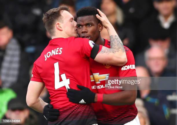 Paul Pogba of Manchester United celebrates with teammate Phil Jones after scoring his team's first goal during the Premier League match between...