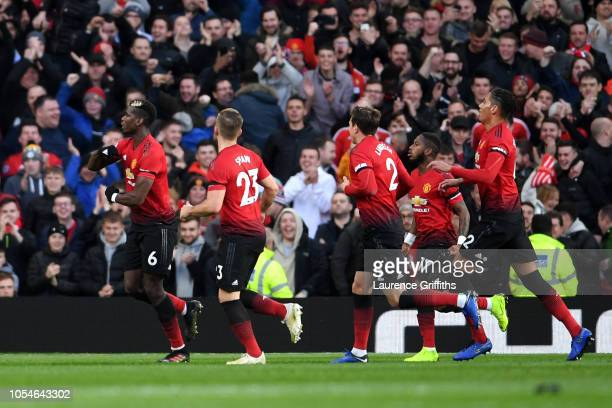 Paul Pogba of Manchester United celebrates with teammates after scoring his team's first goal during the Premier League match between Manchester...