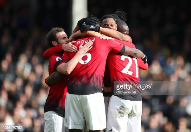 Paul Pogba of Manchester United celebrates with teammates after scoring his team's third goal during the Premier League match between Fulham FC and...