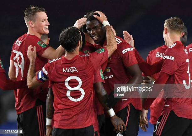 Paul Pogba of Manchester United celebrates with teammates after scoring his sides third goal during the Carabao Cup fourth round match between...