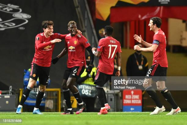 Paul Pogba of Manchester United celebrates with teammates Victor Lindeloef, Fred and Harry Maguire after scoring their team's fifth goal during the...
