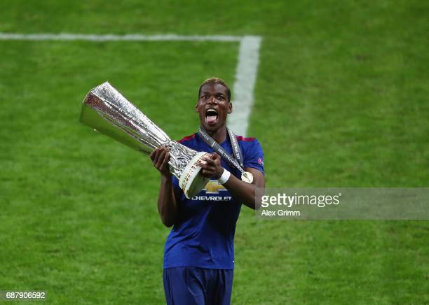 Paul Pogba of Manchester United celebrates with The Europa League trophy after the UEFA Europa League Final between Ajax and Manchester United at...