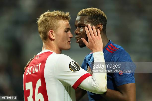 Paul Pogba of Manchester United clashes with Matthijs de Ligt of Ajax during the UEFA Europa League Final between Ajax and Manchester United at...