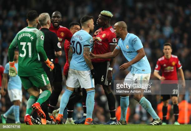 Paul Pogba of Manchester United clashes with Nicolas Otamendi of Manchester City during the Premier League match between Manchester City and...
