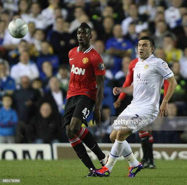 Paul Pogba of Manchester United clashes with Robert Snodgrass of Leeds United during the Carling Cup Third Round match between Leeds United and...