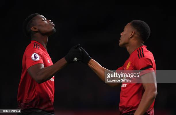 Paul Pogba of Manchester United congratulates Anthony Martial on scoring the second goal during the Premier League match between Manchester United...