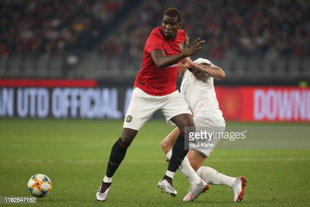 Paul Pogba of Manchester United controls the ball against Kalvin Phillips of Leeds during a preseason friendly match between Manchester United and...
