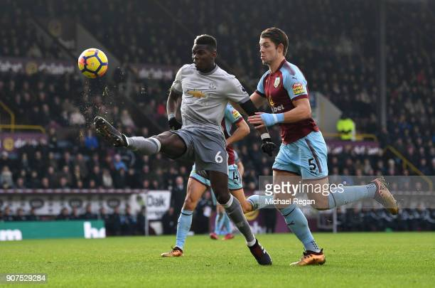 Paul Pogba of Manchester United controls the ball while under pressure from James Tarkowski of Burnley during the Premier League match between...