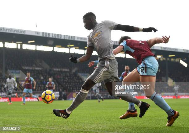 Paul Pogba of Manchester United crosses the ball while under pressure by James Tarkowski of Burnley during the Premier League match between Burnley...
