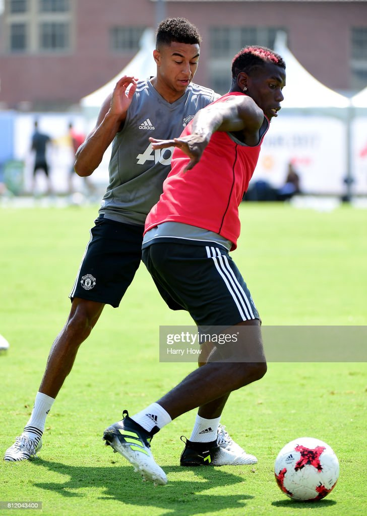 Paul Pogba #6 of Manchester United dribbles away from Jesse Lingard #14 during training for Tour 2017 at UCLA's Drake Stadium on July 10, 2017 in Los Angeles, California.