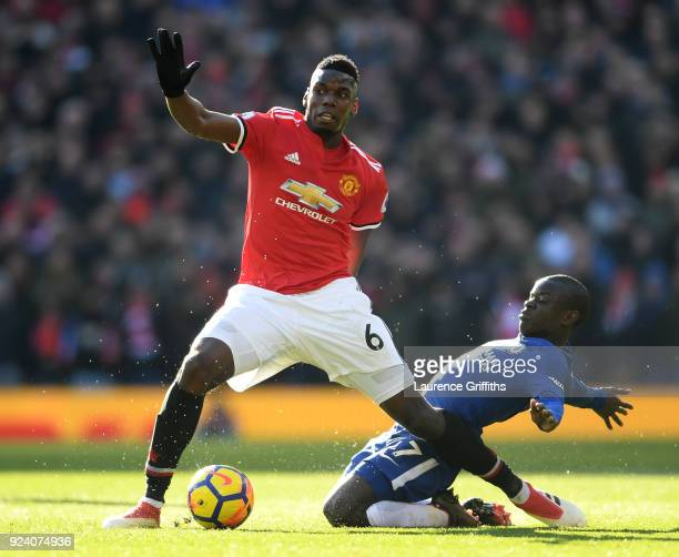 Paul Pogba of Manchester United falls after being tripped by N'Golo Kante of Chelsea during the Premier League match between Manchester United and...