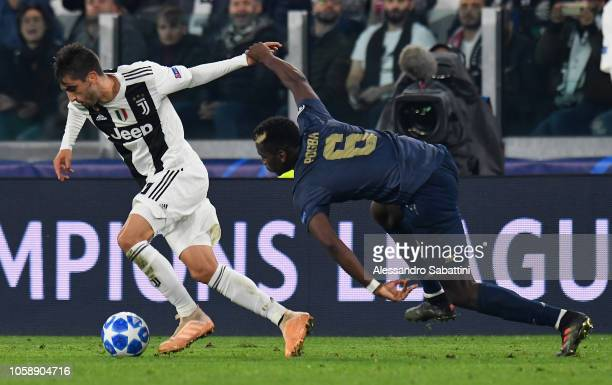Paul Pogba of Manchester United FC competes for the ball with Rodrigo Bentancur of Juventus during the Group H match of the UEFA Champions League...