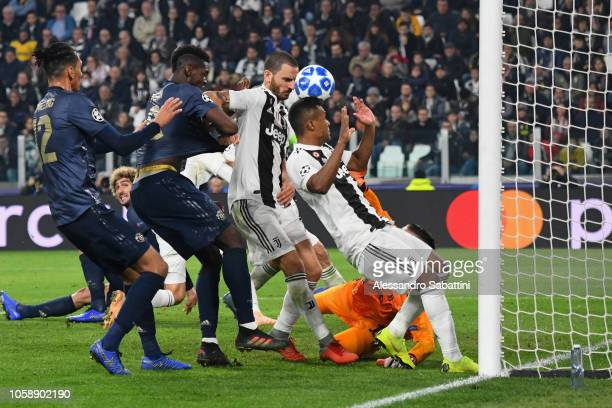 Paul Pogba of Manchester United FC struggles with Alex Sandro of Juventus and scores his team's second goal during the Group H match of the UEFA...