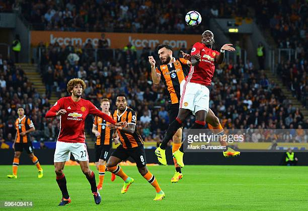 Paul Pogba of Manchester United gets above Robert Snodgrass of Hull City to win a header during the Premier League match between Hull City and...