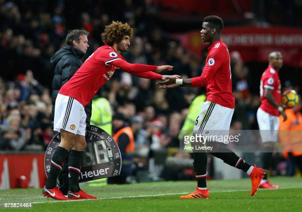 Paul Pogba of Manchester United gives a high five to Marouane Fellaini of Manchester United when being substituted during the Premier League match...