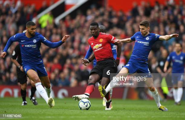 Paul Pogba of Manchester United goes bteween Ruben LoftusCheek and Jorginho of Chelsea during the Premier League match between Manchester United and...