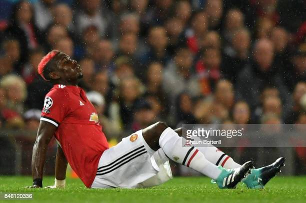 Paul Pogba of Manchester United goes down injured during the UEFA Champions League Group A match between Manchester United and FC Basel at Old...
