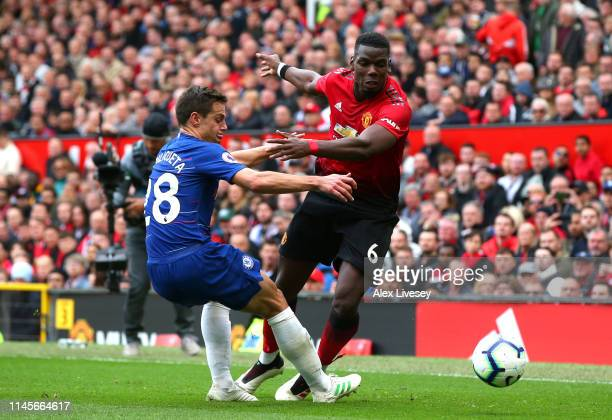 Paul Pogba of Manchester United goes past Cesar Azpilicueta of Chelsea during the Premier League match between Manchester United and Chelsea FC at...