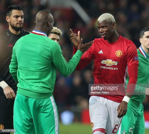 Paul Pogba of Manchester United greets his brother Florentin Pogba of AS Saint-Etienne ahead of the UEFA Europa League Round of 32 first leg match...