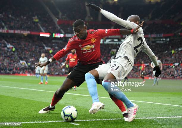 Paul Pogba of Manchester United holds off Angelo Ogbonna of West Ham United during the Premier League match between Manchester United and West Ham...