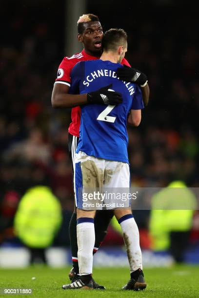 Paul Pogba of Manchester United hugs Morgan Schneiderlin of Everton after the Premier League match between Everton and Manchester United at Goodison...