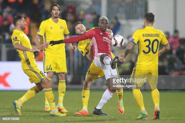 Paul Pogba of Manchester United in action against FC Rostov players during the UEFA Europa League Round of 16 first leg match between FC Rostov and...