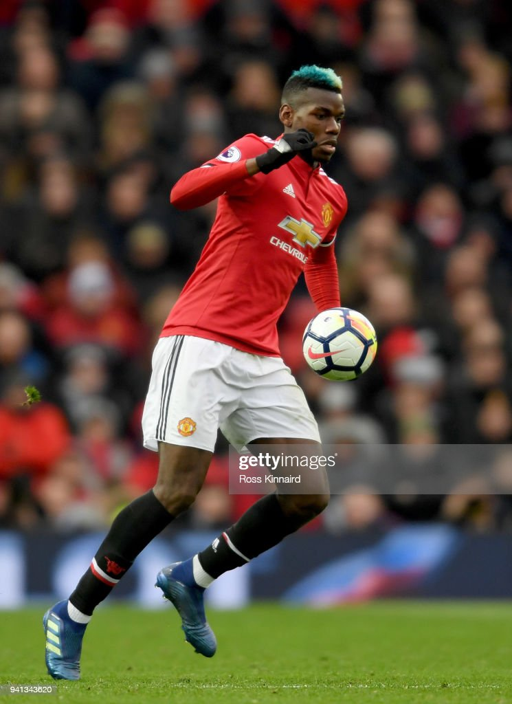 Paul Pogba of Manchester United in action during the Premier League match between Manchester United and Swansea City at Old Trafford on March 31, 2018 in Manchester, England.