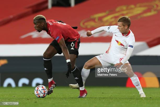 Paul Pogba of Manchester United in action wih Dani Olmo of RB Leipzig during the UEFA Champions League Group H stage match between Manchester United...