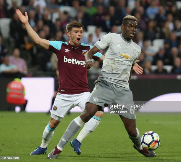 Paul Pogba of Manchester United in action with Aaron Cresswell of West Ham United during the Premier League match between West Ham United and...