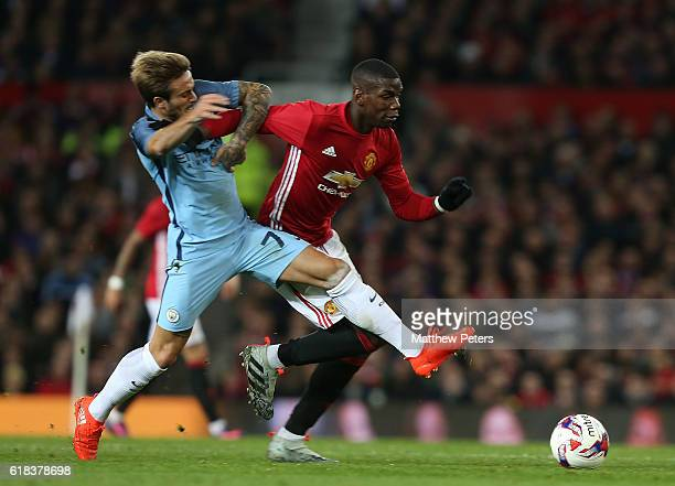 Paul Pogba of Manchester United in action with Aleix Garcia of Manchester City during the EFL Cup Fourth Round match between Manchester United and...